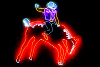 Image of neon cowboy at Saddle West Hotel