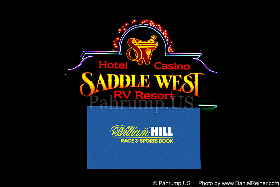 Saddle West Hotel Sign at Night